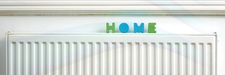 radiator with home sign on top of it